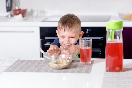 Young Boy Pushing Away Bowl of Breakfast Cereal