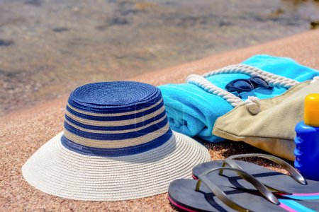 Assorted beach accessories on the sand