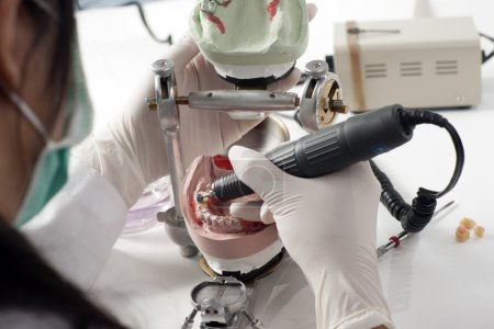 Photo for Dental technician working with articulator in dental laboratory - Royalty Free Image