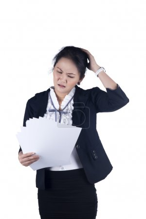 Unhappiness and stress business woman reading reports.