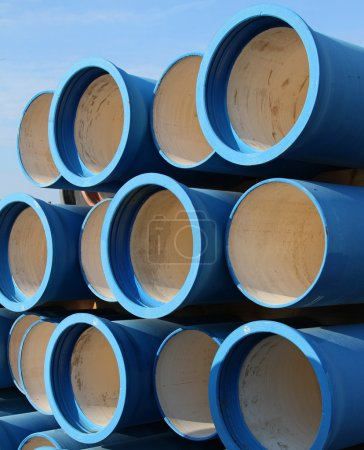 Photo for Huge blue tubes for waterworks and sewer system of the city - Royalty Free Image