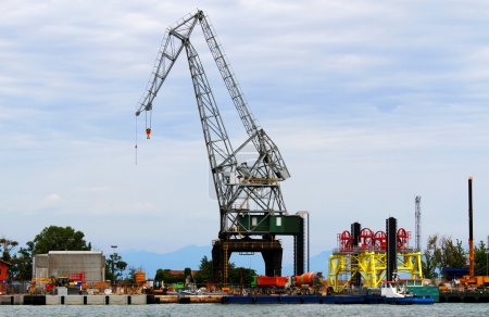 cranes in construction site by the sea for the construction of a