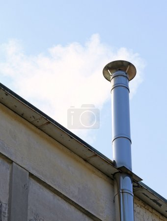 chimney smoke of the heating system in winter