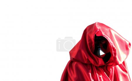 Person dressed in black mask and red dress