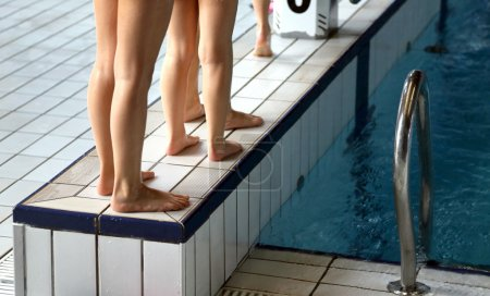 legs of children during the course of indoor pool