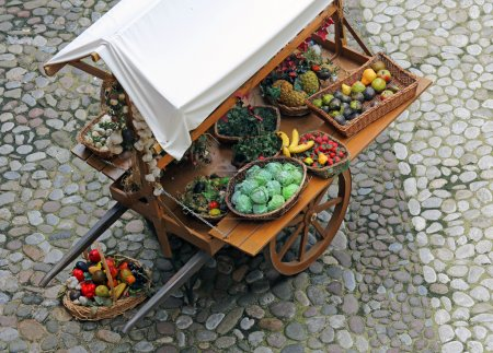 Cart with fruits and vegetables for sale