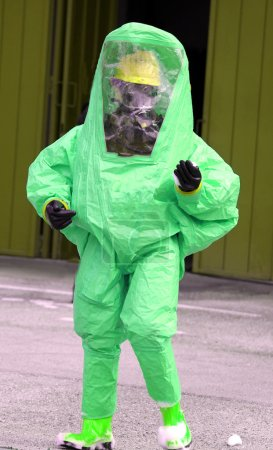 Man with green protective suit against biological risk