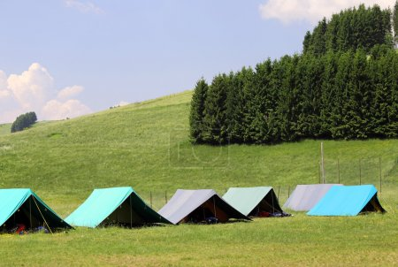 large tents to sleep during the summer camp in the mountain
