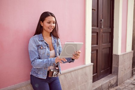 Pretty smiling girl with a tablet pc