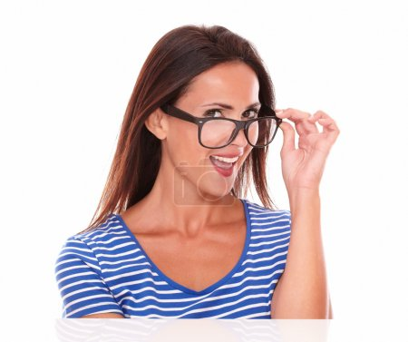 Photo for Cheerful lady smiling and wearing spectacles while looking at camera, in white background - Royalty Free Image
