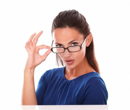 Photo for Charming lady with glasses looking at you in white background - Royalty Free Image