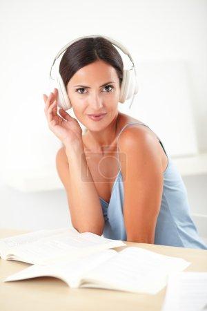 Stylish woman sitting and listening to music