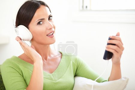 Caucasian woman listening to music