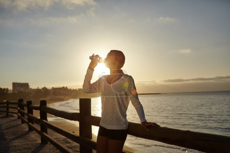 runner drinking from bottle
