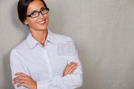 Satisfied young lady standing arms crossed