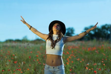 Photo for Beautiful stylish girl in a summer field - Royalty Free Image
