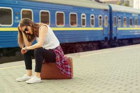 Photo for Woman waiting for a train. Retro toned image - Royalty Free Image