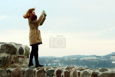 Girl walking on the wall of Vilnius Gediminas castle wall