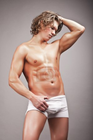 Portrait of mid adult man in briefs