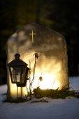 tombstone reflecting evening light