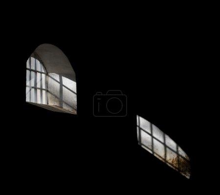 Light shining through barred window