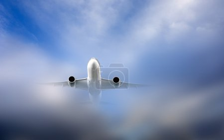 Aircraft just coming out of the clouds