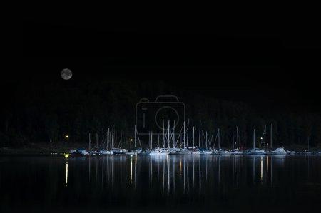 Moored yachts at night
