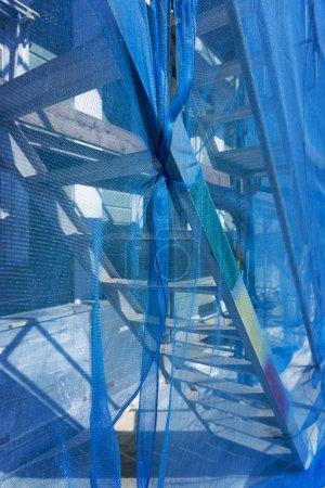 Scaffolding with debris netting