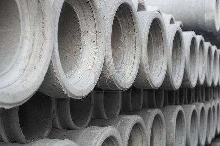 row of concrete pipes