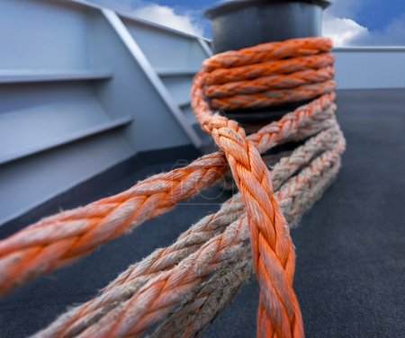 Strong orange rope on ship deck