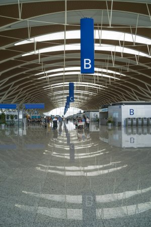 Airport terminal with reflection in floor