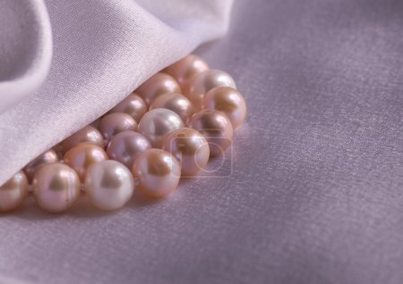 Pearls necklace on silk fabric