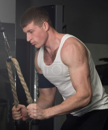 Man doing triceps exercise