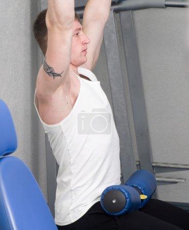 muscular sporty man in gymnasium