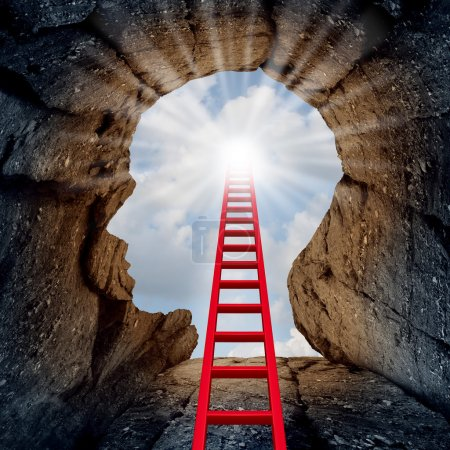 Photo pour Concept of open mind as a a deep mountain cliff shaped as a human head with a ladder leading to the outside towards a glowing sun as a psychology and mental health metaphor for spiritual discovery. - image libre de droit