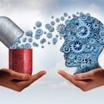 Brain medicine mental health care concept as hands...