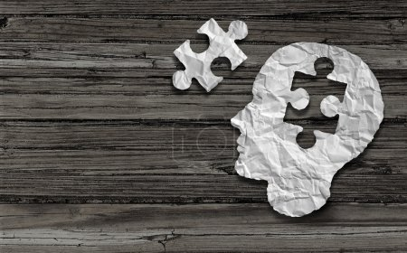 Photo for Mental health symbol Puzzle and head brain concept as a human face profile made from crumpled white paper with a jigsaw piece cut out on a rustic old double page spread horizontal wood background. - Royalty Free Image