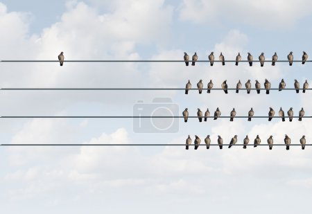 Photo for Individuality symbol and independent thinker concept and new leadership concept or individuality as a group of pigeon birds on a wire with one individual bird in the opposite direction as a business icon for new innovative thinking. - Royalty Free Image