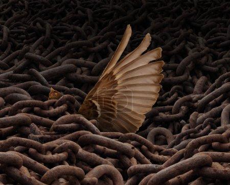 Photo pour Lutte pour la liberté concept et pesé symbole comme une charge ou un groupe de chaînes métalliques rouillées tenant vers le bas un oiseau piégé avec une aile tendre vers l'aide en essayant de s'échapper . - image libre de droit