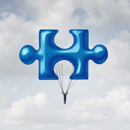 Photo for Leadership jigsaw puzzle concept as a solution metaphor with a businessman floating up to the sky with a balloon shaped as a fundamental key link unit to complete a project. - Royalty Free Image