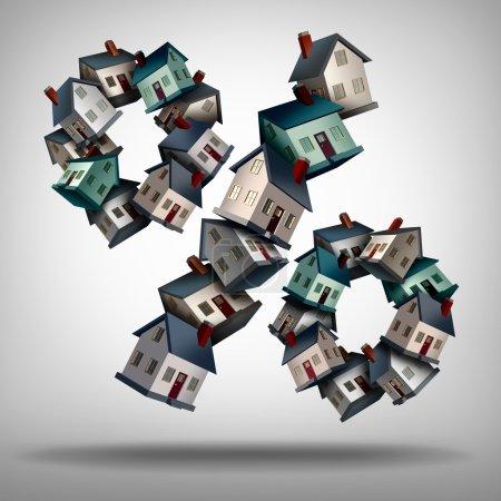Photo pour Concept de taux hypothécaires résidentiels et symbole de taux d'intérêt en tant que groupe de maisons ou de maisons en forme de signe en pourcentage pour un prêt immobilier ou un symbole de pourcentage de l'industrie immobilière . - image libre de droit