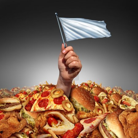 Photo for Junk food surrender and giving up fatty food or quitting a high fat lifestyle and dieting help concept as a hand holding a white flasg drowning in a heap of greasy fast food as a metaphor for changing eating habits by surrendering to diet advice. - Royalty Free Image