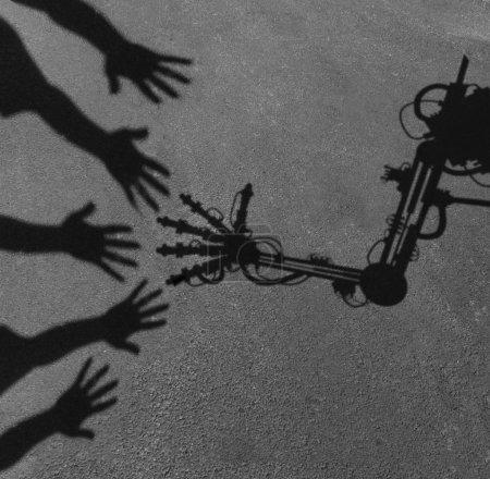 Photo pour Concept de technologie et de société comme ombre d'atteindre des mains de personnes interagissant saluant un bras robot isé de l'ordinateur avancé comme symbole d'assistant de travail et de vie et symbole de question sociale d'intelligence artificielle. - image libre de droit