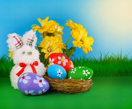 Easter background with eggs in the nest and rabbit