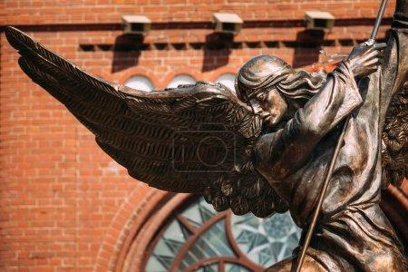 Statue Of Archangel Michael near Red Catholic Church Of St. Simo