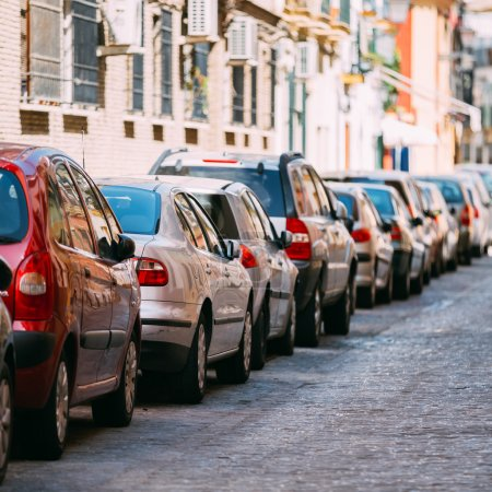 Cars parked on street in European city