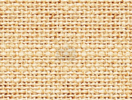 Light rigid weaving of natural fibers texture. Knitting, canvas or burlap background.
