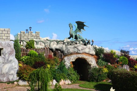 Photo for Fantasy landscaping with a dragon, cave and castle walls. - Royalty Free Image