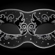 Vector illustration of black mask with silver deco...