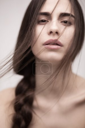 Closeup portrait of a fashion model with long hair...